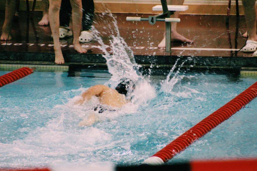 Jaxson Burrage swims the Free in the 400 Relay.