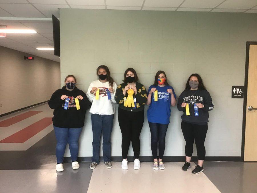 Members of Envirothon team pose with ribbons